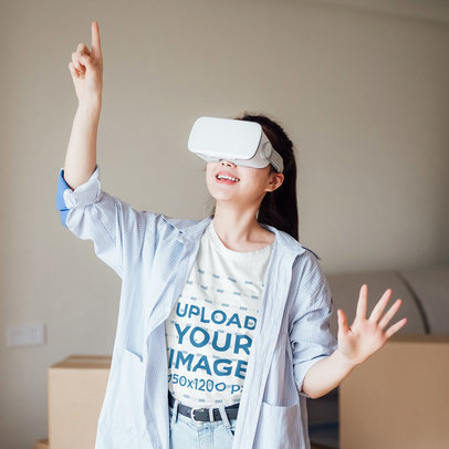 T-Shirt Mockup of a Woman Playing with a VR Headset On 39782-r-el2