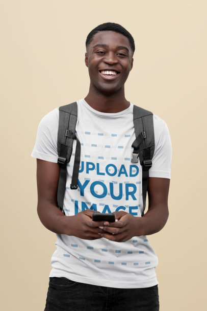 Mockup of a College Student with a Basic T-Shirt Standing at a Studio 43853-r-el2