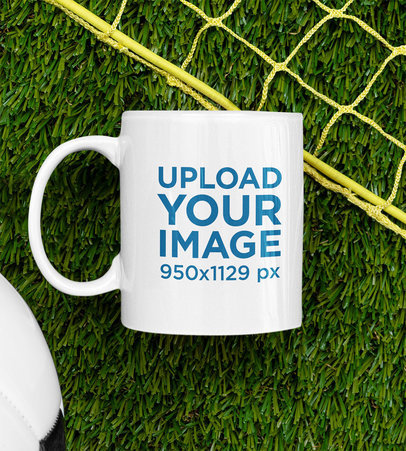 Mockup of an 11 oz Mug Placed by a Soccer Ball and a Net m397