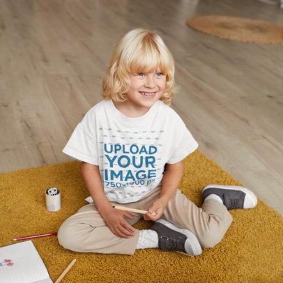 T-Shirt Mockup of a Happy Kid Drawing at Home 44657-r-el2