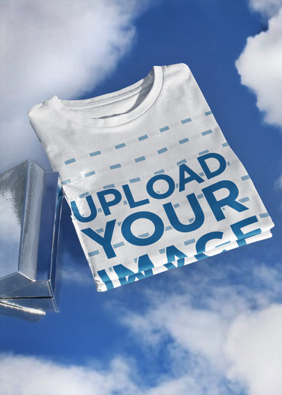Mockup of a Basic T-Shirt Featuring a Cool Sky Background m607