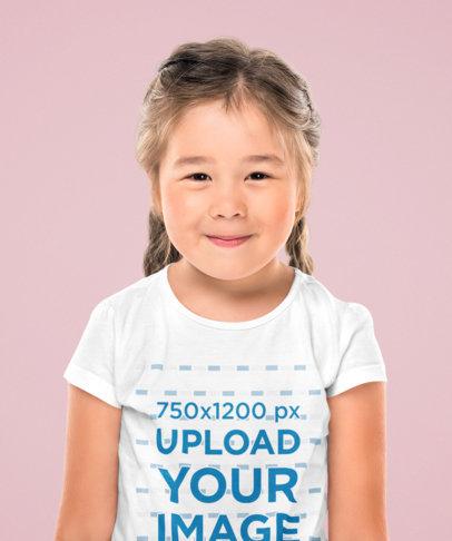Mockup of a Little Girl Wearing a T-Shirt at a Studio 44447-r-el2