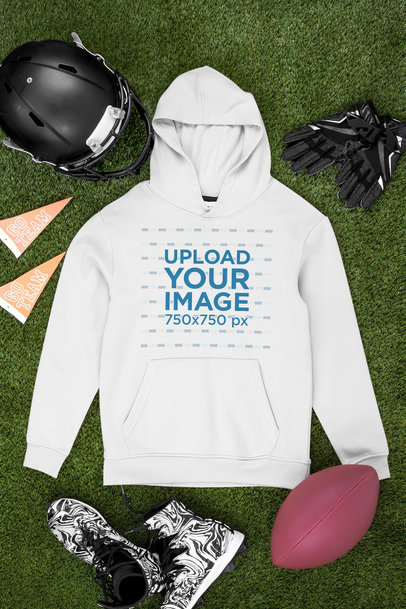 Mockup of a Flat Laid Hoodie by Football Garments m361