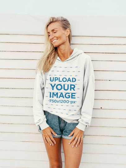Pullover Hoodie Mockup of a Happy Woman Leaning on a White Wall 44362-r-el2
