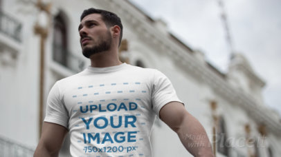 Parallax Video of a Muscular Man Wearing a T-Shirt in the City 2506