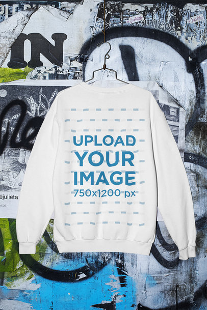 Mockup of a Sweatshirt Hanging Against a Wall with Graffiti M429
