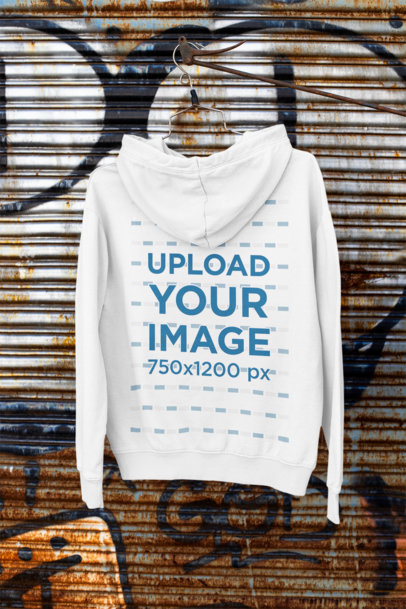 Back-View Mockup of a Hanged Hoodie by a Rusty Wall m449