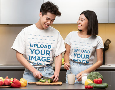 T-Shirt Mockup Featuring a Young Couple Cooking at Home 44434-r-el2