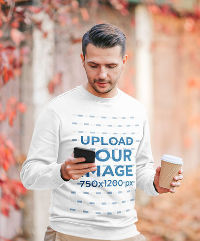 Sweatshirt Mockup Featuring a Man Checking His Phone on an Autumn Day 44622-r-el2