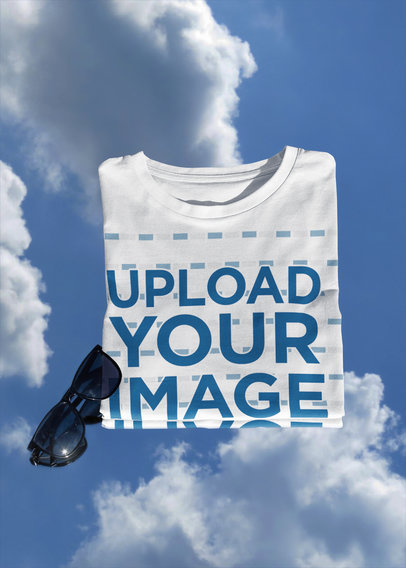 Mockup of a Folded T-Shirt Featuring a Blue Sky Background m611