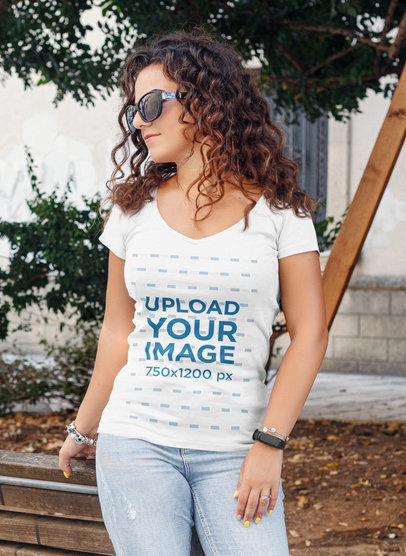 Mockup of a Curly-Haired Woman Wearing a Deep V-Neck T-Shirt 44739-r-el2