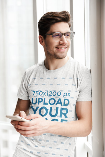 T-Shirt Mockup of a Man Texting by a Window 44339-r-el2