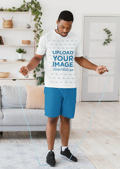 T-Shirt Mockup of a Man Doin a Jumping Rope Workout at Home 44555-r-el2