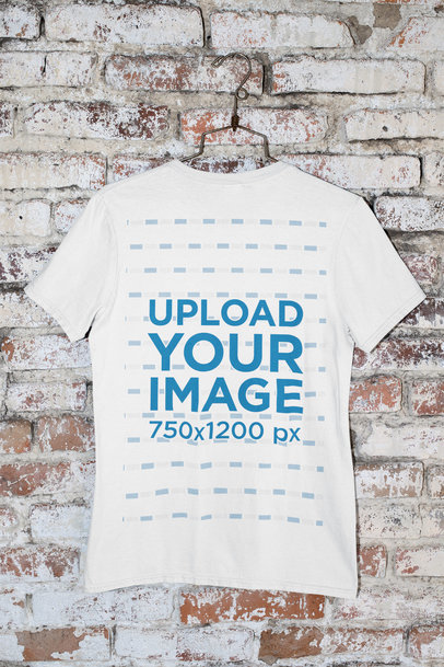 Mockup of a Round Neck T-Shirt Hanged by a Brick Wall m438