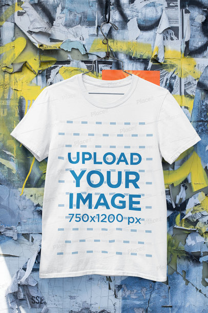 Mockup of a Hanged Round Neck T-Shirt Against an Urban Wall m430