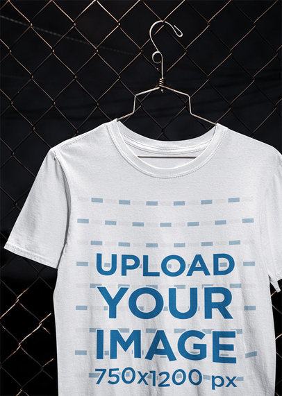 Mockup of a T-Shirt Hanging From a Chain-Link Fence m488