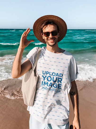 T-Shirt Mockup of a Happy Man Hanging Out at the Beach 45099-r-el2