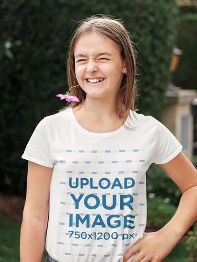 T-Shirt Mockup of a Teen Girl Playing with a Flower 45043-r-el2