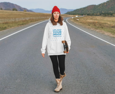 Pullover Hoodie Mockup Featuring a Woman Walking on a Road and Holding a Longboard 45123-r-el2
