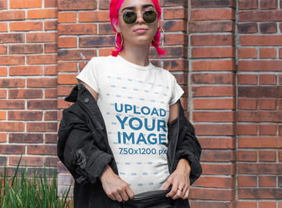 T-Shirt Mockup of a Woman With Pink Hair Posing by a Brick Wall m407