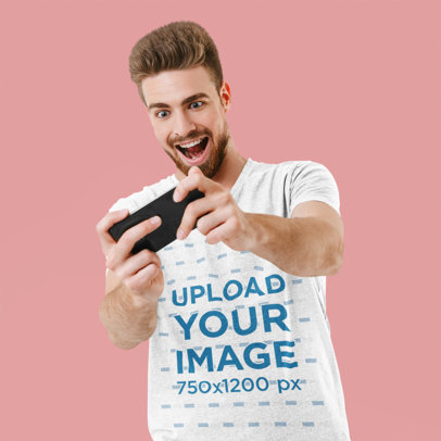 Mockup of a Man with a Heathered T-Shirt Playing on the Phone 45147-r-el2