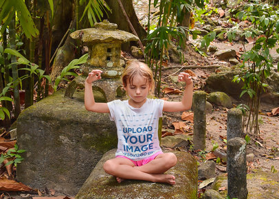 T-Shirt Mockup of a Little Girl Meditating in the Jungle 45038-r-el2