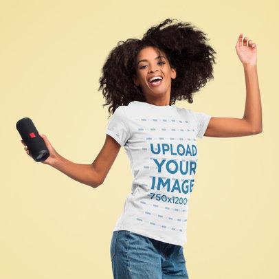 Mockup of a Happy Woman With a T-Shirt Jumping at a Studio 45062-r-el2