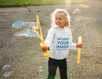 Hoodie Mockup of a Girl Playing With Bubbles at a Park 45335-r-el2