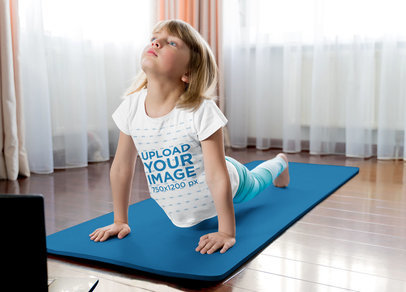 T-Shirt Mockup of a Little Blonde Girl Doing Yoga in Her House 45317-r-el2