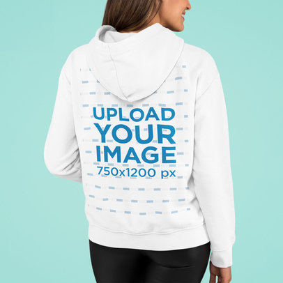 Mockup of a Woman Showing the Back of Her Hoodie in a Studio m763