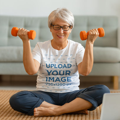 T-Shirt Mockup Featuring a Senior Woman Holding a Pair of Dumbbells 45433-r-el2