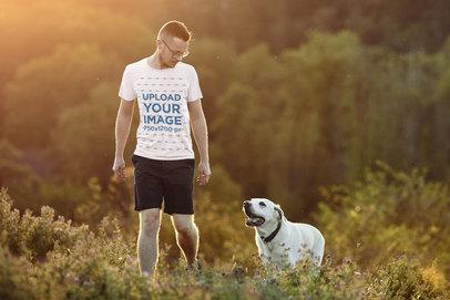 T-Shirt Mockup of a Man Walking His Dog Outdoors 45601-r-el2