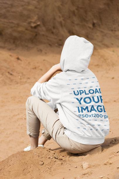 Hoodie Mockup of a Woman Resting in a Desert 45634-r-el2
