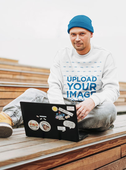 Sweatshirt Mockup Featuring a Man Working on His Laptop 45656-r-el2