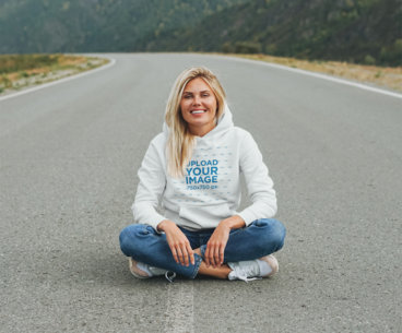Hoodie Mockup Featuring a Woman Sitting on an Empty Road 45627-r-el2