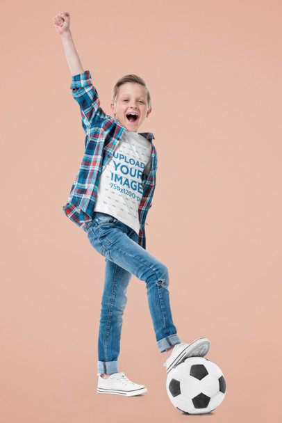 T-Shirt Mockup of a Boy Playing With a Soccer Ball at a Studio 45296-r-el2