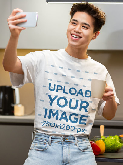 T-Shirt Mockup of a Young Man Taking a Selfie in a Kitchen 45966-r-el2