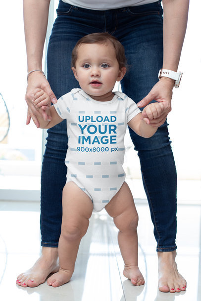 Mockup of a Baby Girl Wearing a Sublimated Onesie m927