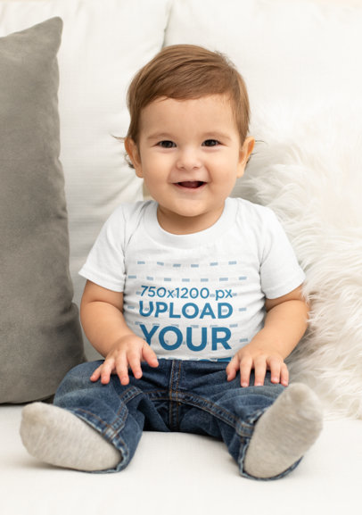 T-Shirt Mockup of a Smiling Baby on a Sofa M1006