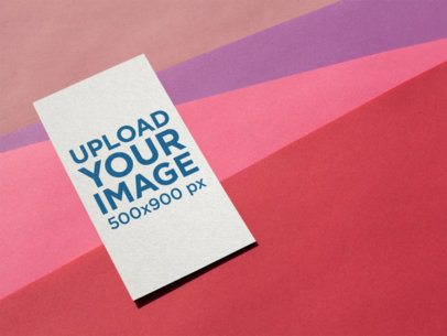 Vertical Business Card Mockup on a Multi-Colored Surface a14990