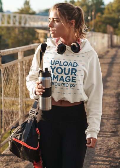 Mockup of a Woman Wearing a Crop Top Hoodie While Walking to the Gym 46218-r-el2