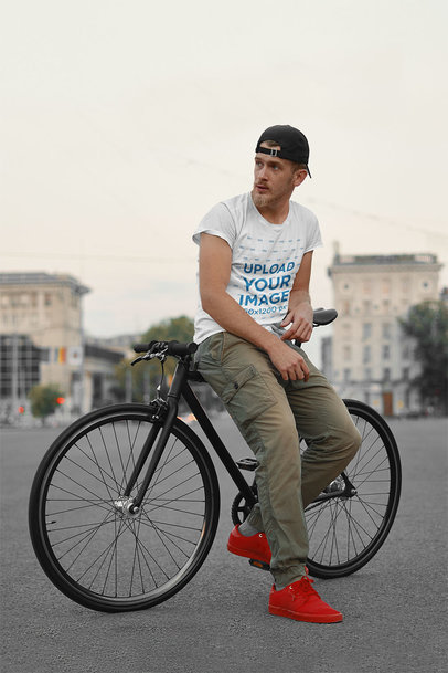 Basic T-Shirt Mockup Featuring a Serious Man Sitting on His Bike 43140-r-el2