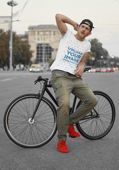 Basic Tee Mockup of a Man Posing With His Bike in the City 43142-r-el2