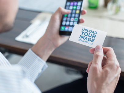 Mockup of a Business Man Using a Business Card to Contact a Person with his Phone a15032