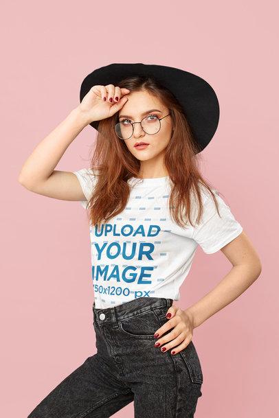 T-Shirt Mockup Featuring a Woman Posing at a Studio 46407-r-el2
