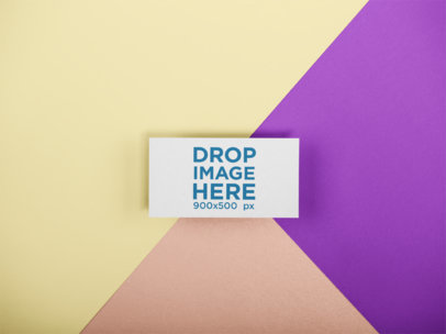 Business Card Template Lying on a Surface with Three Colors a15137