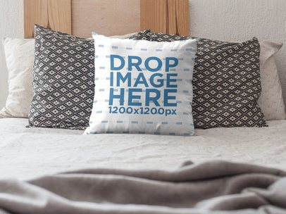 Mockup of a Square Pillow on a Bed with Pillows a15172