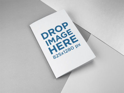 Bifold Brochure Mockup Lying on a Surface with Three Colors a15192