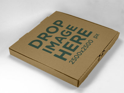 Mockup of a Pizza Box Lying on a Solid Color Surface a15221