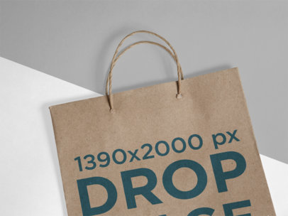 Closeup Mockup of a Paper Bag Lying on a Multicolor Surface a15305